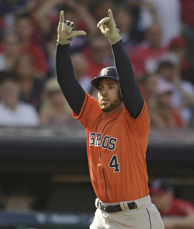 Houston Astros' George Springer reacts after hitting a solo home run off Cleveland Indians starting pitcher Mike Clevinger in the fifth inning during Game 3 of a baseball American League Division Series, Monday, Oct. 8, 2018, in Cleveland. (AP Photo/David Dermer)