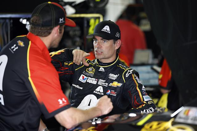 Jeff Gordon, right, talks with a crew member after a practice session for Sunday's NASCAR Sprint Cup Series auto race at Pocono Raceway, Saturday, Aug. 2, 2014, in Long Pond, Pa. (AP Photo/Matt Slocum)