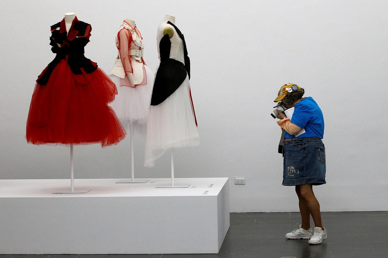 <p>An attendee photographs fashion displays during the 'Rei Kawakubo/Commes Des Garcons: Art of the In-Between' during the The Metropolitan Museum of Art's Costume Institute Spring 2017 exhibition, in New York City, U.S., May 1, 2017. (Brendan McDermid/Reuters) </p>