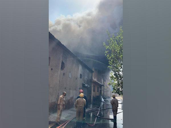 Firefightng operations underway at the shoe factory in Udyog Nagar on Monday. [Photo/ANI]