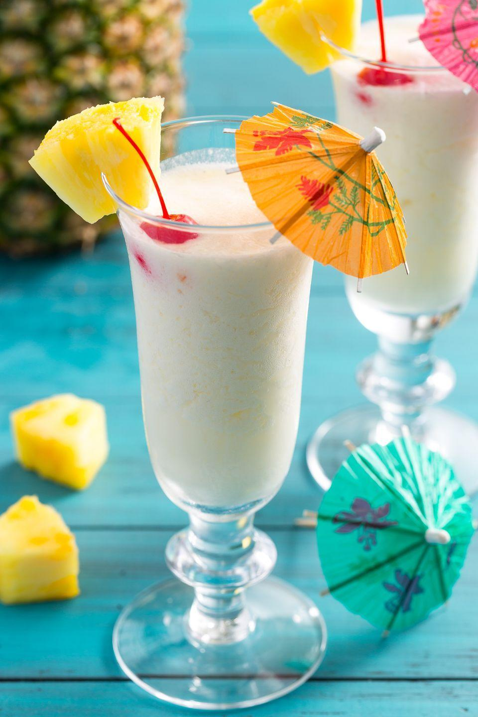 """<p>Is it even a piña colada without an umbrella in it?</p><p>Get the recipe from <a href=""""https://www.delish.com/cooking/recipe-ideas/recipes/a4262/pina-colada-drinks-cocktails/"""" rel=""""nofollow noopener"""" target=""""_blank"""" data-ylk=""""slk:Delish"""" class=""""link rapid-noclick-resp"""">Delish</a>.<br></p>"""
