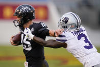 Iowa State quarterback Brock Purdy (15) breaks a tackle by Kansas State defensive back Kiondre Thomas (3) during the first half of an NCAA college football game, Saturday, Nov. 21, 2020, in Ames, Iowa. (AP Photo/Charlie Neibergall)