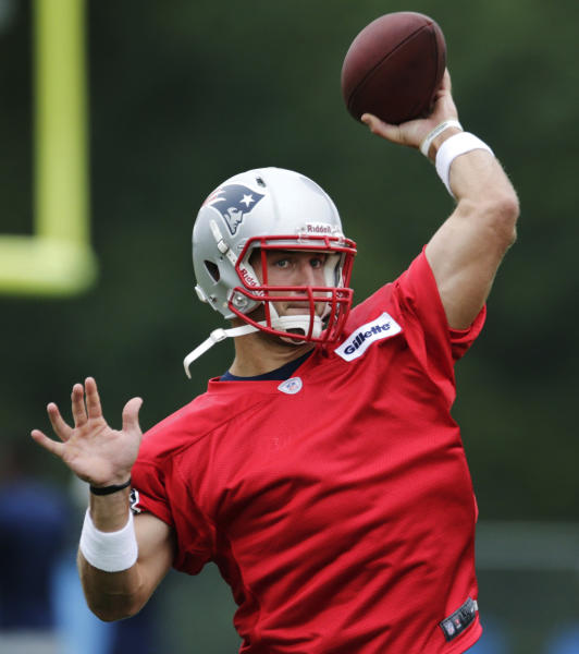 New England Patriots quarterback Tim Tebow throws during a team football practice in Foxborough, Mass., Tuesday June 11, 2013. (AP Photo/Charles Krupa)