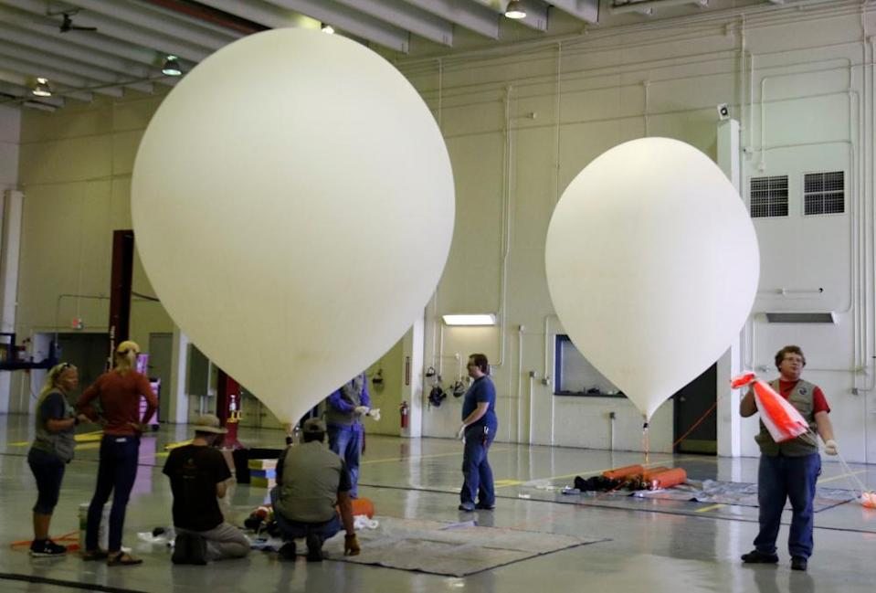 NASA students launch high-altitude balloons in Casper Collage Wyoming in 2017. Researchers are planning to run test at reflecting the sun's heat by releasing calcium carbonate into the stratosphere using high altitude scientific balloons.