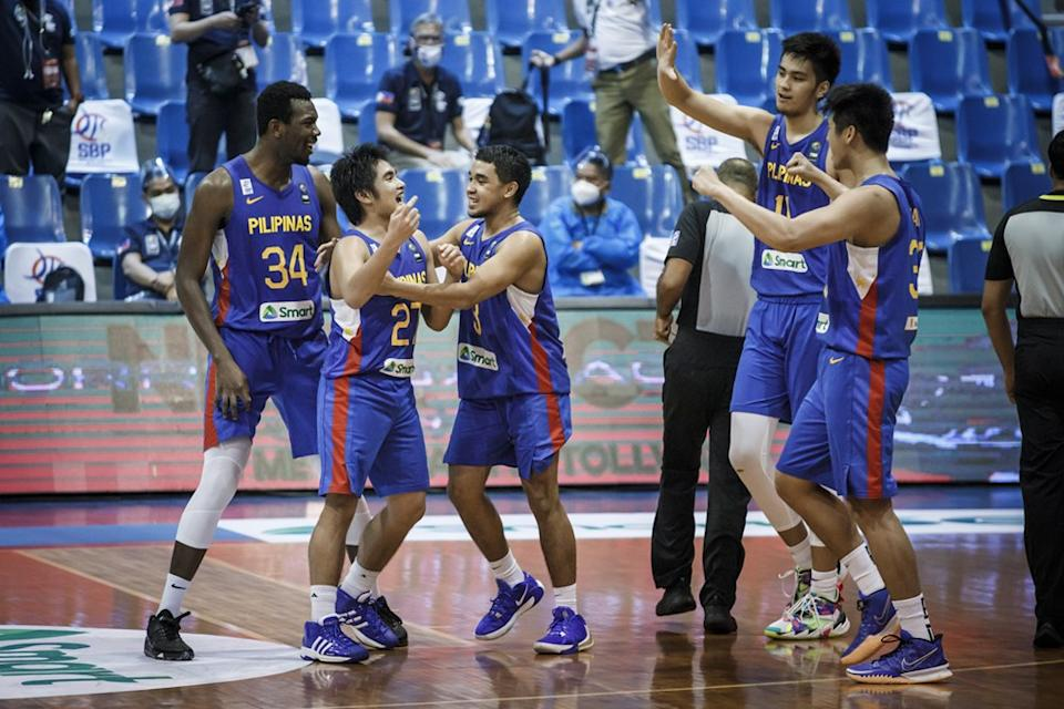 SJ Belangel celebrates with Gilas Pilipinas teammates after taking charge down the stretch against South Korea. (Photo: FIBA Basketball)