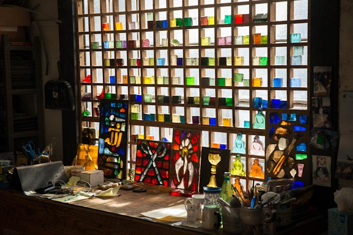 "<div class=""caption""> Glass samples in the cutting room of Judson Studios, 2019. </div> <cite class=""credit"">Photo: Courtesy of Judson Studios</cite>"