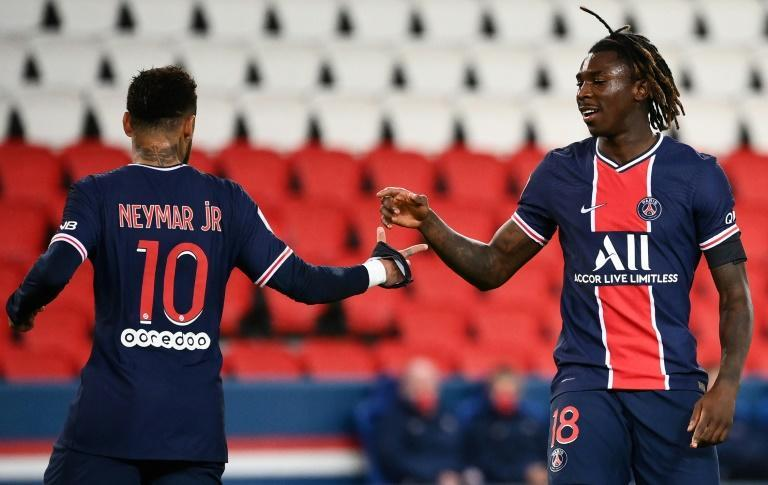 Moise Kean (R) celebrates with Neymar after scoring in PSG's 4-0 win over Dijon