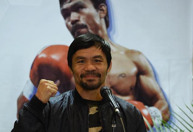 Philippine boxing icon Manny Pacquiao last month polled his legion of social media followers on who he should fight next (AFP Photo/TED ALJIBE)