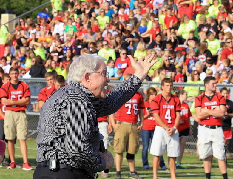 Former Baylor head football coach Grant Teaff addresses the West Trojan football players, background, and the community on Thursday, Aug. 29, 2013, at a morning pep rally in West, Texas. The West Trojans open the season Thursday night on their field that was used as a triage site when West Fertilizer Plant exploded on April 17, where 15 people died. (AP Photo/ Waco Tribune Herald, Jerry Larson)