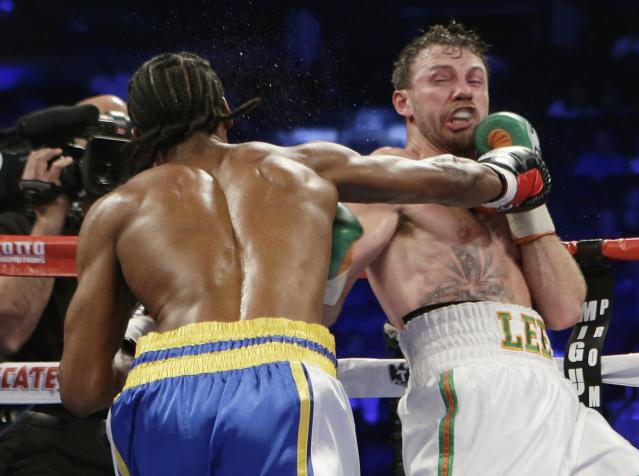Andy Lee, of Ireland, right, knocks out John Jackson, of St. Thomas, Virgin Islands, during the fifth round of a NABF Super Welterweight Title boxing match Saturday, June 7, 2014, in New York. Lee won the fight with a knockout in the fifth round. (AP Photo/Frank Franklin II)