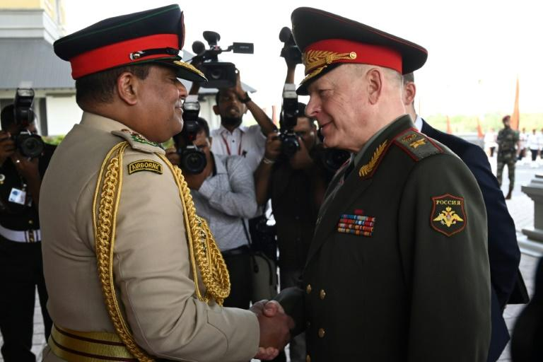 Sri Lanka's Army chief Shavendra Silva (left) shakes hands with Russia's commander-in-chief of ground forces, Oleg Salyukov, at the army headquarters in Colombo in February 2020