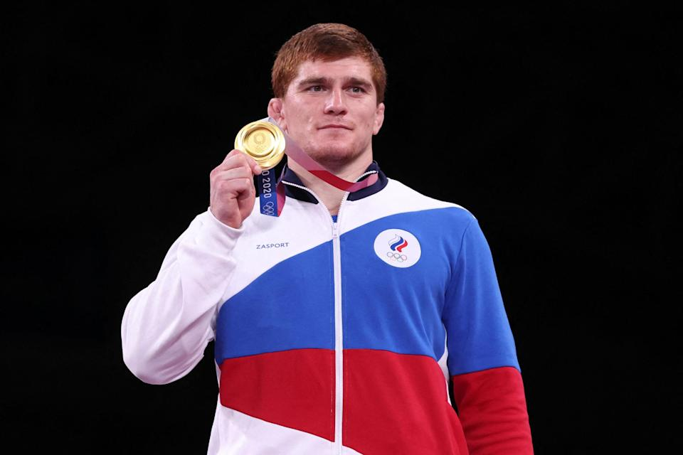 Image: Gold medalist Russia's Musa Evloev (Jack Guez / AFP - Getty Images)