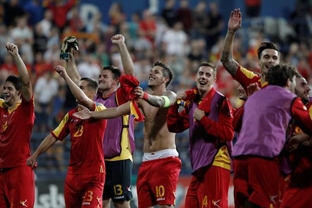 Soccer Football - 2018 World Cup Qualifications - Europe - Montenegro vs Romania - Podgorica, Montenegro - September 4, 2017 - Montenegro team celebrates. REUTERS/Stevo Vasiljevic