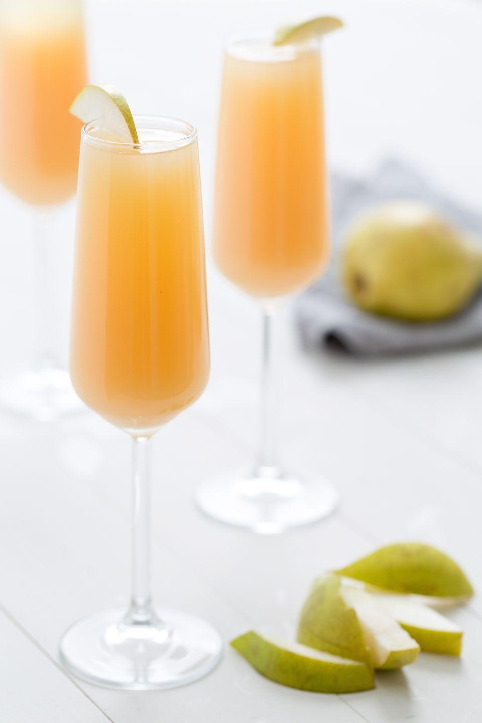 "<p>On its own, pear nectar can be a little, well, thick. But cut it with 2 parts dry champagne and you're in business.</p><p>Get the recipe from <a href=""https://www.delish.com/cooking/recipe-ideas/recipes/a46970/pear-mimosas-recipe/"" rel=""nofollow noopener"" target=""_blank"" data-ylk=""slk:Delish"" class=""link rapid-noclick-resp"">Delish</a>.</p>"