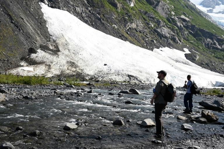 Two hikers take stock of a fast-receding glacier near Portage Lake in Girdwood, Alaska, amid record high temperatures in that northern state (AFP Photo/Lance King)