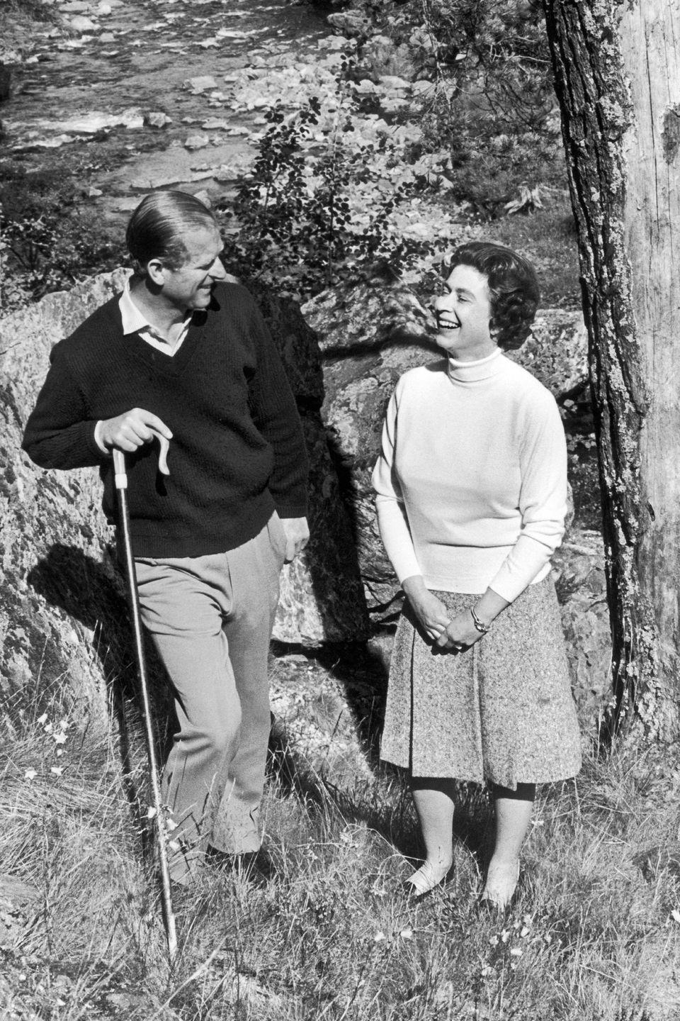 <p>Prince Philip and Queen Elizabeth share a laugh while celebrating their silver wedding anniversary at the Balmoral Castle in Scotland. </p>