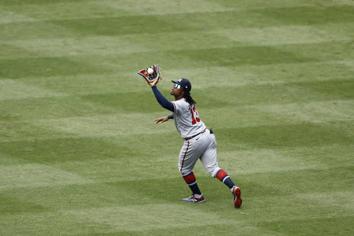 Atlanta Braves center fielder Ronald Acuna Jr. catches a fly out by Philadelphia Phillies' Neil Walker during the fourth inning of the first baseball game in a doubleheader, Sunday, Aug. 9, 2020, in Philadelphia. (AP Photo/Matt Slocum)