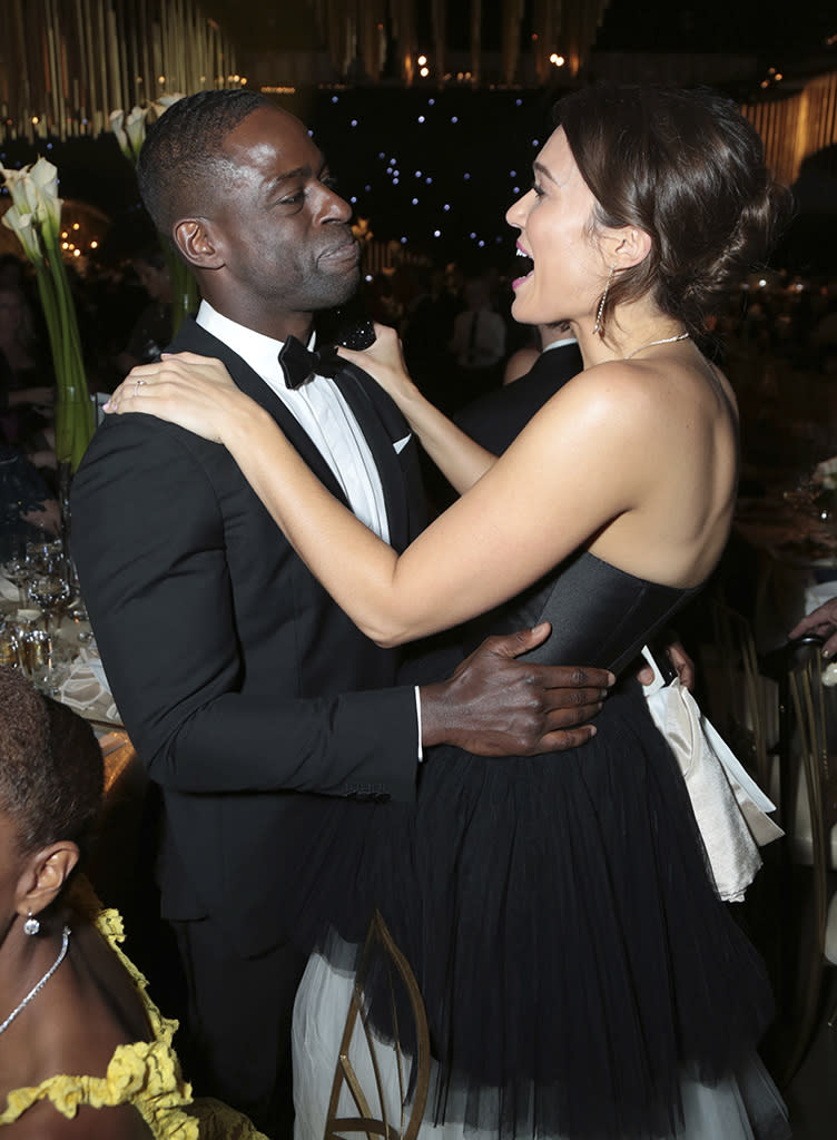 """<p>Sterling K. Brown became the first black actor to win for Outstanding Lead Actor in a Drama Series since 1998 — and celebrated at the Governors Ball at the Los Angeles Convention Center with his <em>This Is Us</em> family, including Mandy Moore. Although his speech was cut short, we did hear the bit where he called his co-stars Mandy, Milo Ventimiglia, Justin Hartley, and Chrissy Metz """"the best white TV family that a brother has ever had, better than the white folks who raised Webster."""" (Photo: Alex Berliner/Invision for the Television Academy/AP Images) </p>"""