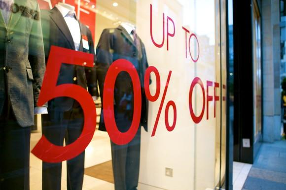Image of 50% sale sign in retail window.