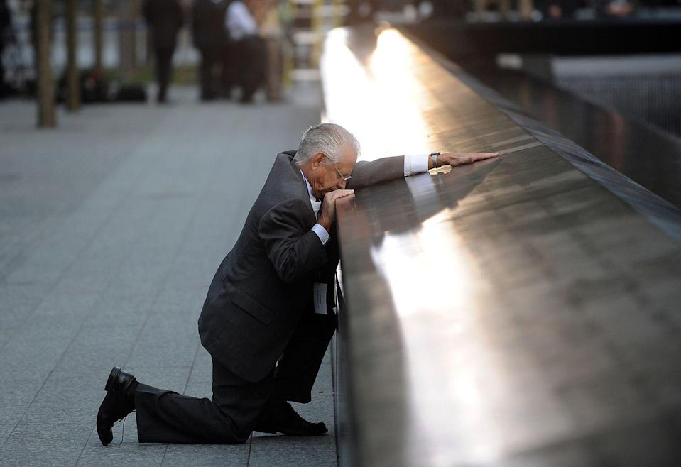 <p>2011. Robert Peraza, who lost his son Robert David Peraza, pauses at his son's name at the North Pool of the 9/11 Memorial during the 10th anniversary ceremonies at the site of the World Trade Center.</p>