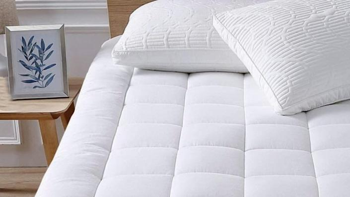 Mattress pads should be used to keep mattresses clean, but some come with cooling features to help you sleep on summer nights.