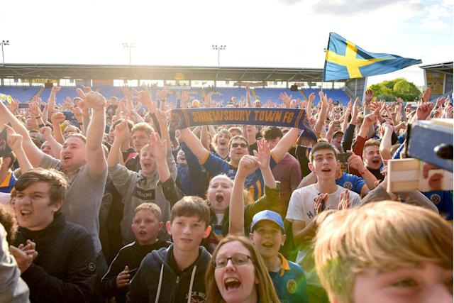"Soccer Football - League One Play Off Semi Final Second Leg - Shrewsbury Town vs Charlton Athletic - Montgomery Waters Meadow, Shrewsbury, Britain - May 13, 2018 Shrewsbury Town fans celebrate at full time Action Images/Paul Burrows EDITORIAL USE ONLY. No use with unauthorized audio, video, data, fixture lists, club/league logos or ""live"" services. Online in-match use limited to 75 images, no video emulation. No use in betting, games or single club/league/player publications. Please contact your account representative for further details."