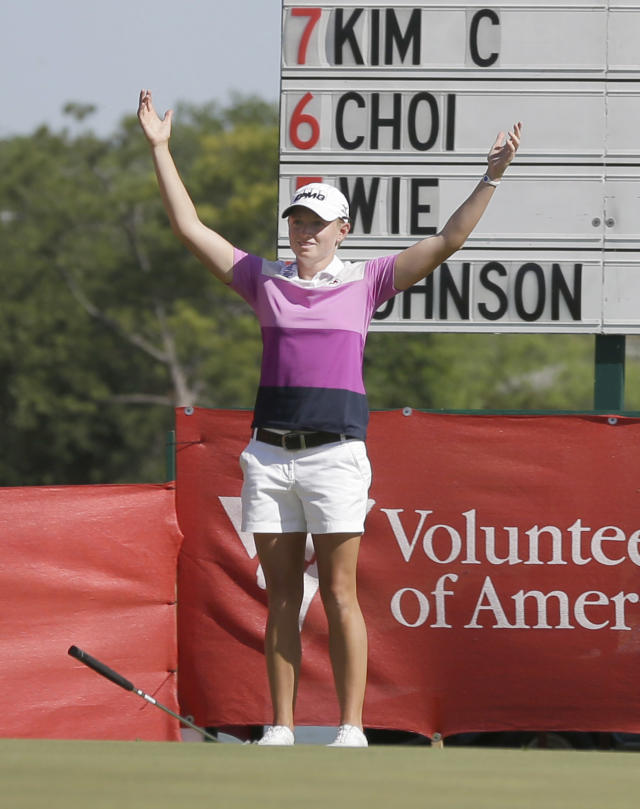 Stacy Lewis reacts after sinking her putt on the 18th hole and winning the North Texas LPGA Shootout golf tournament at Las Colinas Country Club in Irving, Texas, Sunday, May 4, 2014. Lewis finished the tourney 16-under to win. (AP Photo/LM Otero)
