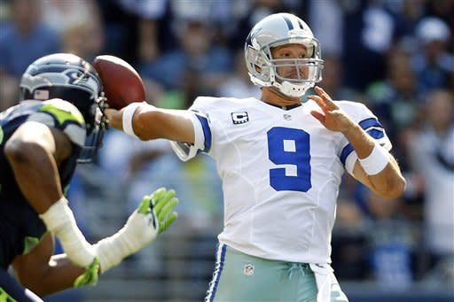 Dallas Cowboys quarterback Tony Romo drops back to pass against the Seattle Seahawks in the second half of an NFL football game, Sunday, Sept. 16, 2012, in Seattle. (AP Photo/John Froschauer)