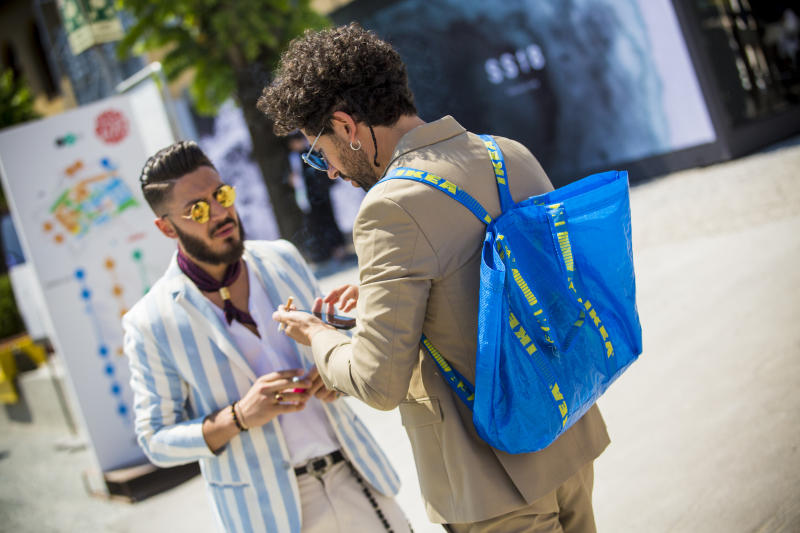 FLORENCE, ITALY - JUNE 13: Guest wears a Ikea backpack during Pitti Immagine Uomo 92. at Fortezza Da Basso on June 13, 2017 in Florence, Italy. (Photo by Claudio Lavenia/Getty Images)