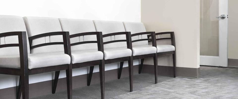 empty chairs in a doctors office waiting area