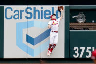 St. Louis Cardinals left fielder Tyler O'Neill catches a fly ball by Pittsburgh Pirates' Jacob Stallings at the wall for an out during the second inning in the first game of a baseball doubleheader Thursday, Aug. 27, 2020, in St. Louis. (AP Photo/Jeff Roberson)