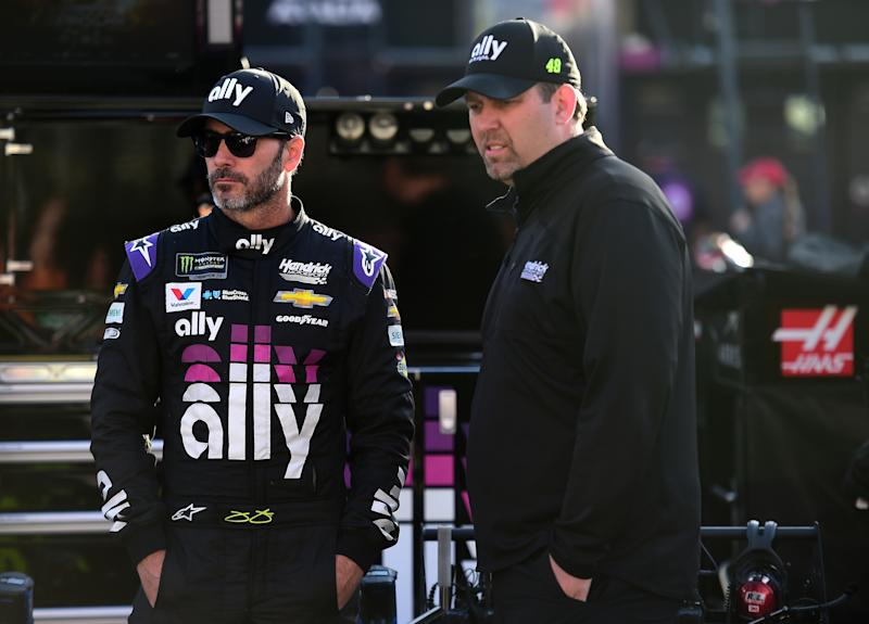 BRISTOL, TN - APRIL 06: Jimmie Johnson, driver of the #48 Ally Chevrolet, stands with his crew chief Kevin Meendering on pit road during practice for the Monster Energy NASCAR Cup Series Food City 500 at Bristol Motor Speedway on April 6, 2019 in Bristol, Tennessee. (Photo by Jared C. Tilton/Getty Images)
