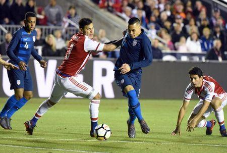Mar 27, 2018; Cary, NC, USA; United States forward Bobby Wood (7) attempts to shoot against Paraguay defender Gustavo Gomez (3) during the first half of an international friendly men's soccer match at WakeMed Soccer Park. Rob Kinnan-USA TODAY Sports