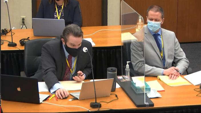 In this image from the video, defense counsel Eric Nelson on the left, defendant and former Minneapolis police officer Derek Chauvin on the right, and Hennepin County Judge Peter at Chauvin's trial on Tuesday, April 6, 2021.・ I've heard that Kay Hill is presiding over.