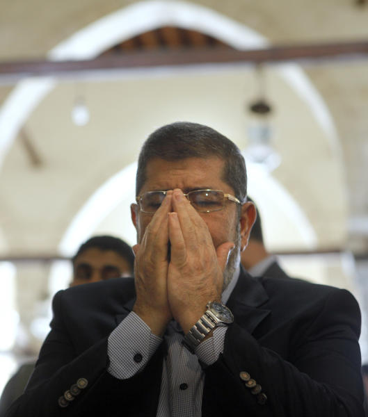 The Muslim Brotherhood's presidential candidate, Mohammed Morsi, prays in Amr Ibn Al-As mosque in Cairo, Egypt, Friday, June 22, 2012. Egypt's ruling military council on Friday blamed the Muslim Brotherhood for raising tensions by releasing presidential election results early and insisted its recent decisions that granted the generals sweeping powers were necessary for running the country. (AP Photo/Amr Nabil)