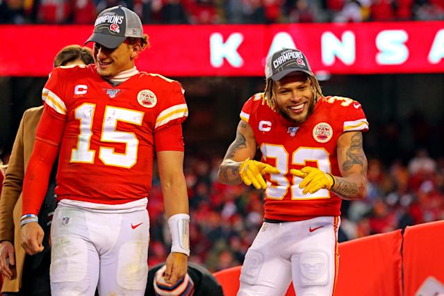 The Chiefs' Tyrann Mathieu (32) and Patrick Mahomes soak in the glory after Kansas City won its first AFC title in 50 years. (Jay Biggerstaff-USA TODAY Sports)