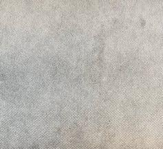 """<span class=""""caption"""">The regular pattern of tiny point welds can be seen in this sample of washable, industry-grade white spunbond polypropylene.</span> <span class=""""attribution""""><span class=""""source"""">(Mark Diamond/Veratex Lining Ltd.)</span></span>"""