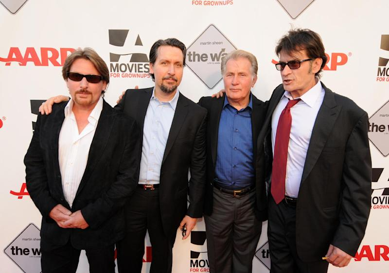 "FILE - In this Sept. 23, 2011 file image  originally released by AARP, from left, Emilio Estevez, Ramon Estevez, Martin Sheen and Charlie Sheen pose at the premiere of Emilio's film, ""The Way,"" as part of AARP's Festival For Grown Ups at the Nokia Theatre in Los Angeles. Martin Sheen admits to guilt about how his offspring were affected, in earlier years, by the alcoholism that bedeviled him and by his consuming career ambitions. If he had it to do over again he wouldn't have had four children, he says, he would have had eight: ""For how do we know ourselves but through our children?"" (AP Photo/AARP, Doug Van Sant)"