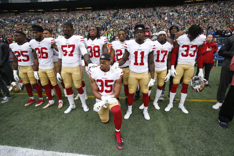 <strong>Eric Reid #35 of the San Francisco 49ers kneels during the anthem with the support of teammates prior to the game against the Seattle Seahawks at CenturyLink Field on September 17.</strong> (Michael Zagaris via Getty Images)