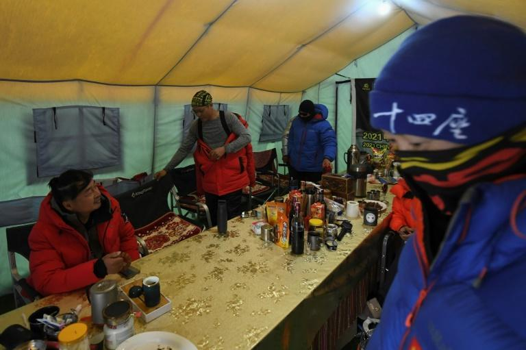 The usual reverie and loud communal parties at the base camp are absent this year after expedition groups were asked to keep to themselves and avoid socialising with others