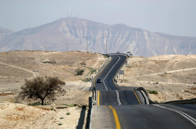 FILE PHOTO: Vehicles drive through a road in Jordan Valley, the eastern-most part of the Israeli-occupied West Bank that borders Jordan
