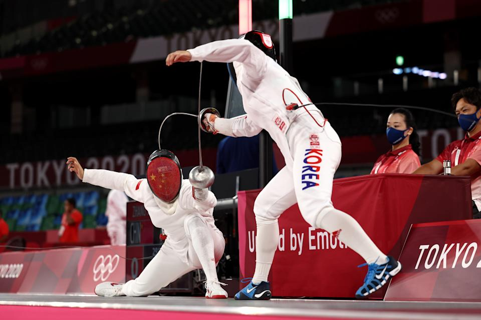 <p> Xiaonan Zhang of Team China and Sunwoo Kim of Team South Korea compete during the Fencing Ranked Round of the Women's Modern Pentathlon on day thirteen of the Tokyo 2020 Olympic Games at Musashino Forest Sport Plaza on August 05, 2021 in Chofu, Japan. (Photo by Leon Neal/Getty Images)</p>