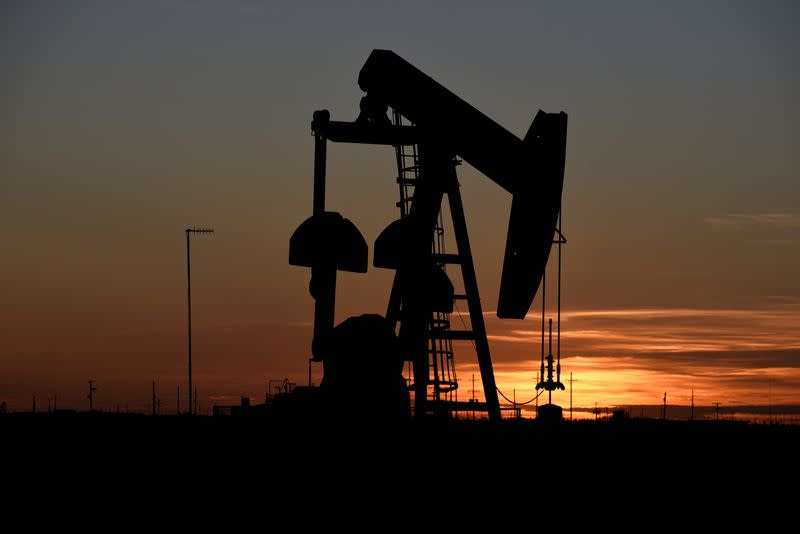 Oil gains on signs of output cuts, improved demand