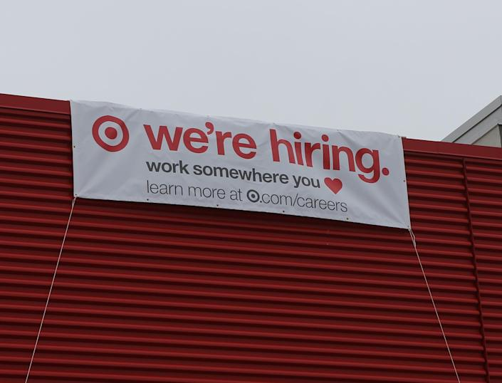 A banner on the side on a new Target location in the Prices Corner Shopping Center advertises that the business is hiring for its grand opening.