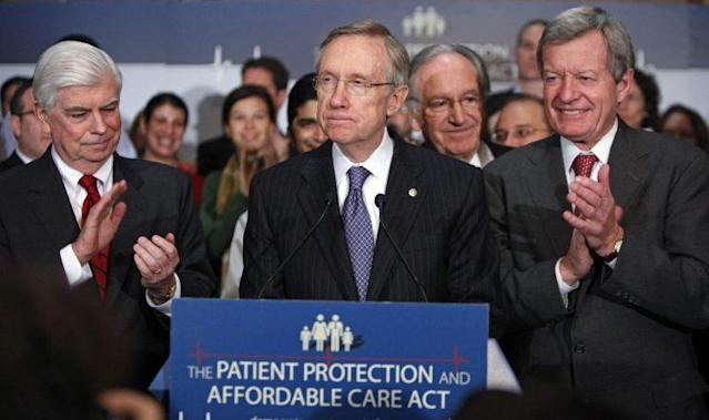 Senate Majority Leader Harry Reid of Nev., center, speaks during a news conference on Capitol Hill, Dec. 22, 2009. (Photo: Haraz N. Ghanbari/AP)