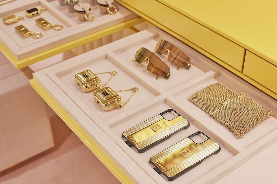 """<p>With most of us now working-from-home, tethered to all manner of tech, there's never been a better time to up our gadget-game.</p><p>If you're wondering how to do that, look no further than Fendi's collaboration with London-based accessories brand CHAOS. </p><p>First seen on the catwalk, the collaboration features a sleek range of gold phone cases and AirPod carriers, shearling-lined laptop sleeves, and more. And you can buy them now at Fendi.com and an exclusive pop-up in <a href=""""https://go.redirectingat.com?id=127X1599956&url=https%3A%2F%2Fwww.harrods.com%2Fen-gb%2Fshopping%2Ffendi&sref=https%3A%2F%2Fwww.elle.com%2Fuk%2Ffashion%2Fg31095508%2Findustry-update%2F"""" rel=""""nofollow noopener"""" target=""""_blank"""" data-ylk=""""slk:Harrods"""" class=""""link rapid-noclick-resp"""">Harrods</a>.</p><p>The pop-up in the renowned department store is Instagram catnip, with a plush pink and yellow interior inspired by Fendi's Autumn/ Winter 2020 show. There's also a genius bar offering advice and the chance to try before you buy - necessary, because there are so many great gadgets, how can one choose?</p><p>Also on display are a series of slick vintage-inspired lighters designed by Charlotte Stockdale and Katie Lyall, the duo behind CHAOS.</p><p>The pop-up is open from 20th October, located on Harrods' lower ground floor.</p><p><a class=""""link rapid-noclick-resp"""" href=""""https://go.redirectingat.com?id=127X1599956&url=https%3A%2F%2Fwww.fendi.com%2Fgb%2Fwoman%2Fhighlights%2Ffendi-x-chaos&sref=https%3A%2F%2Fwww.elle.com%2Fuk%2Ffashion%2Fg31095508%2Findustry-update%2F"""" rel=""""nofollow noopener"""" target=""""_blank"""" data-ylk=""""slk:SHOP NOW"""">SHOP NOW</a></p>"""