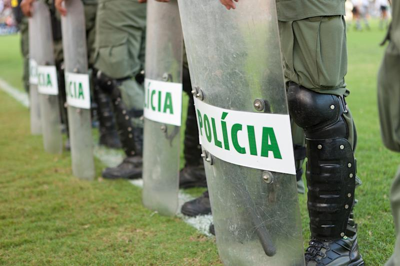 Brazilian riot police on the football pitch.