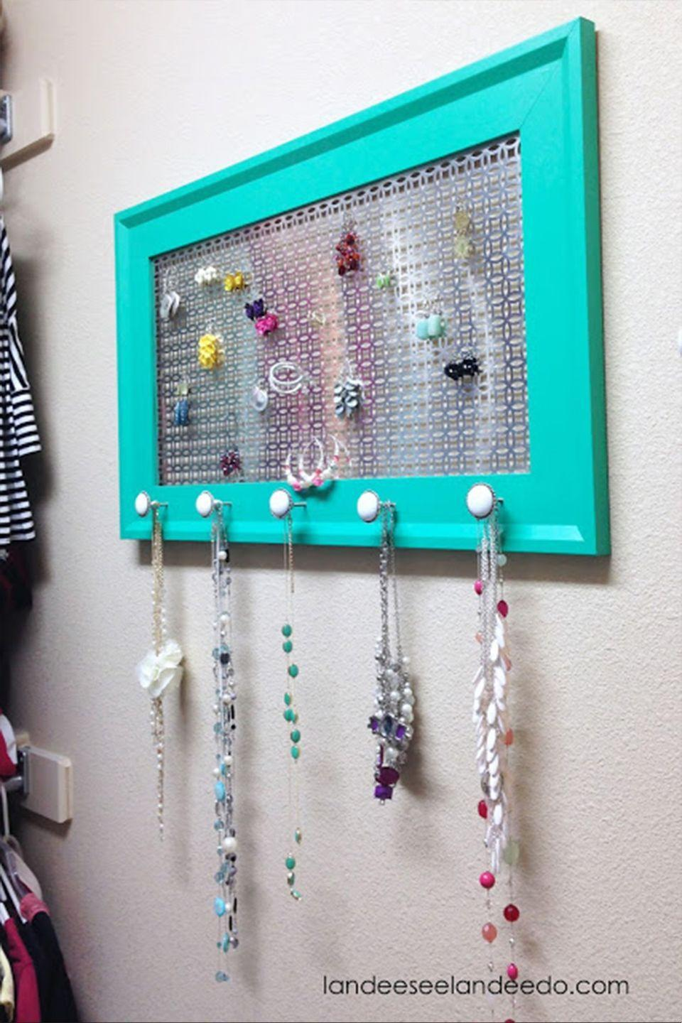 """<p>You and your siblings have given mom lots of handmade jewelry over the years, from macaroni necklaces to funky earrings. Now, it's time to give her a stylish way to organize 'em. </p><p><a href=""""https://www.landeeseelandeedo.com/diy-jewelry-organizer"""" rel=""""nofollow noopener"""" target=""""_blank"""" data-ylk=""""slk:Get the tutorial at Landeelu »"""" class=""""link rapid-noclick-resp""""><em>Get the tutorial at Landeelu »</em></a> </p>"""
