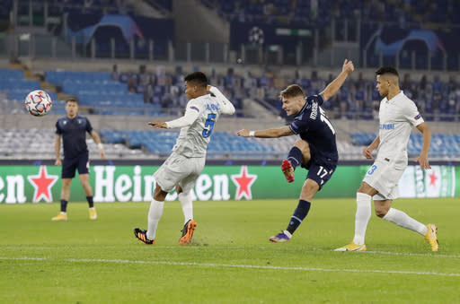Lazio's Ciro Immobile, second from right, scores his side's opening goal during a Champions League group F soccer match between Lazio and Zenit Saint Petersburg, at Rome's Olympic Stadium, Tuesday, Nov. 24, 2020. (AP Photo/Andrew Medichini)