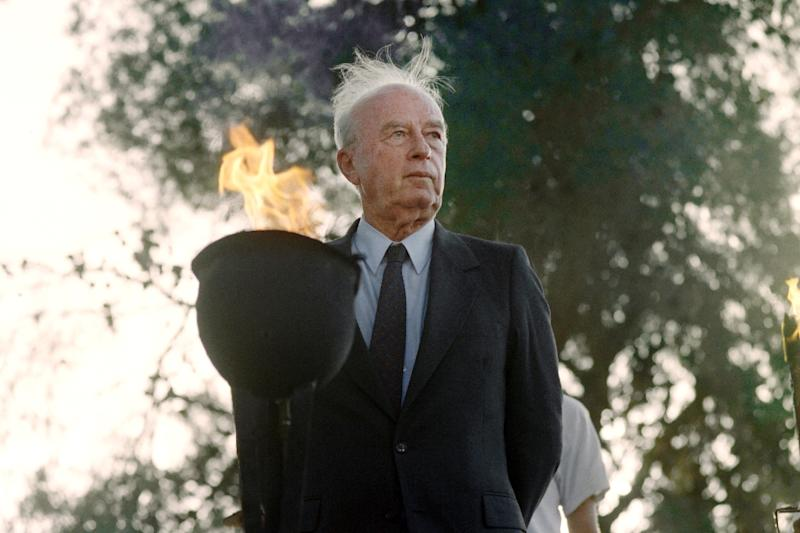 Then Israeli Prime Minister Yitzhak Rabin lights a flame on Jerusalem day at a memorial for soldiers who fell, on May 19, 1993 (AFP Photo/Menahem Kahana)